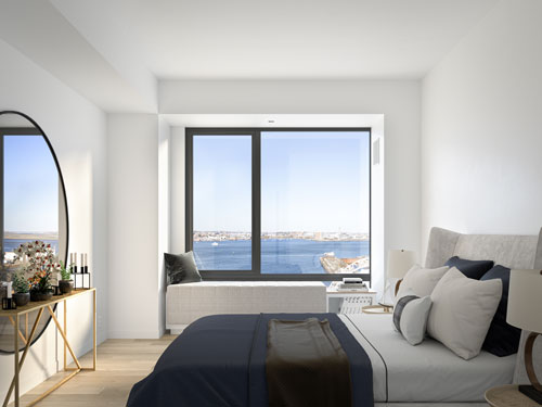 White and blue bedroom with waterfront views at Ora Seaport luxury apartments in Boston, MA