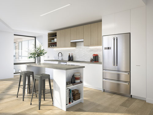 Eat-in kitchen with island and stainless steel refrigerator at Ora Seaport Apartments in Boston, MA