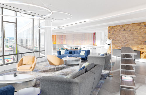 Resident lounge area with fireplace at Ora Seaport luxury apartments in Boston