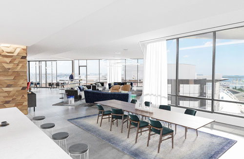 Spacious resident lounge dining and living area at Ora Seaport luxury apartments in Boston