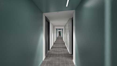 Green hallway lined with black doors and grey carpet
