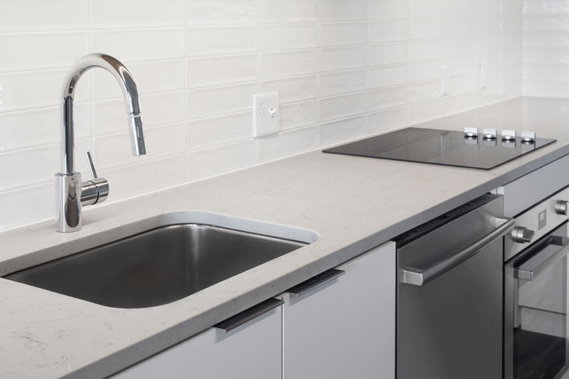 Thumbnail of stainless steel sink and stovetop in apartment kitchen