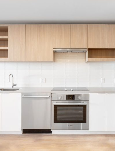 Thumbnail of tan and white kitchen with stainless steel appliances