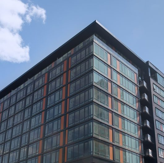 Thumbnail of orange and black modern commercial building