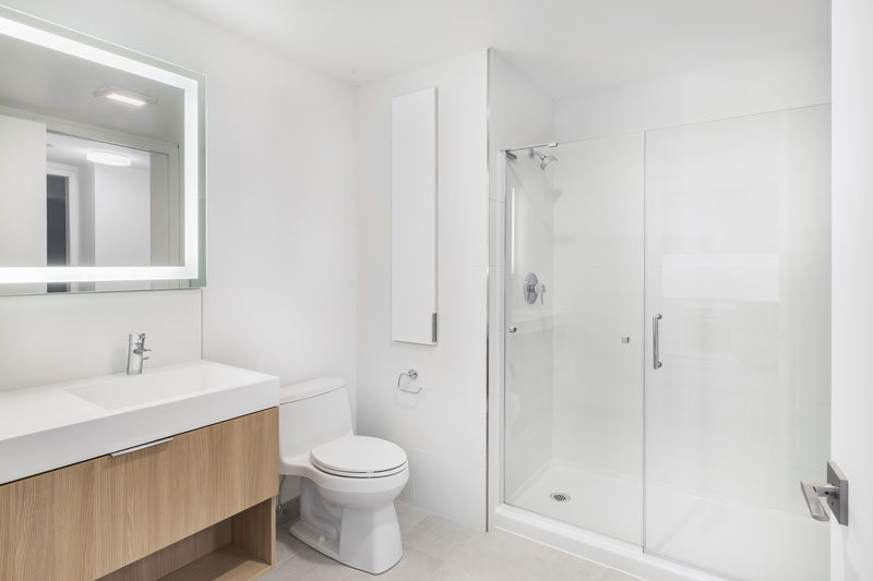 Thumbnail of white apartment bathroom with glass shower