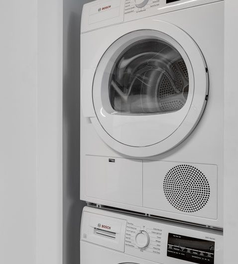 Thumbnail of white stacked washer and dryer unit