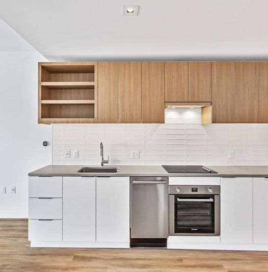 Kitchen with white and light wood cabinets and stainless steel appliances