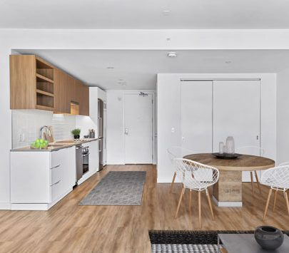 Open concept white and wood paneled kitchen and dining area