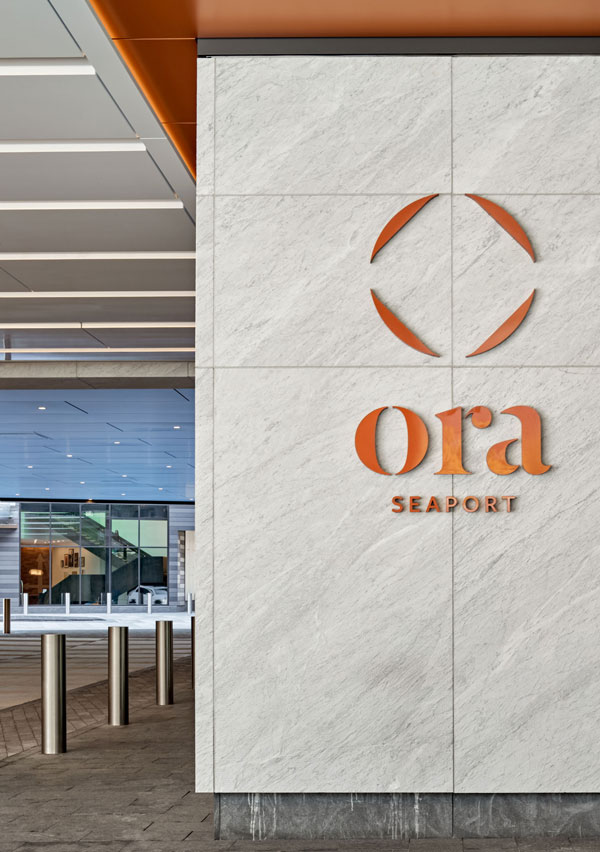 Bronze metal signage for Ora Seaport at entrance