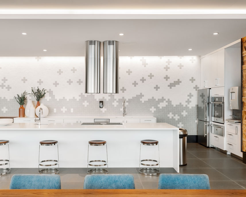 Common area kitchen with white counters and stainless steel appliances