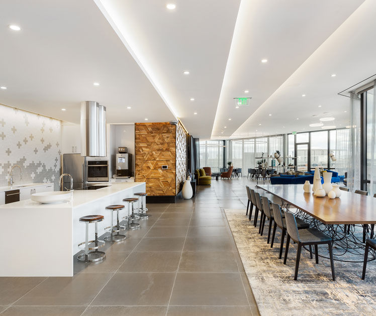 Common area with grey tile floor and full-service kitchen