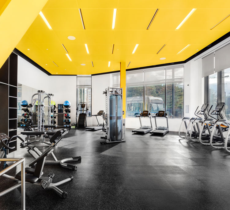 Black and yellow gym with several exercise machines
