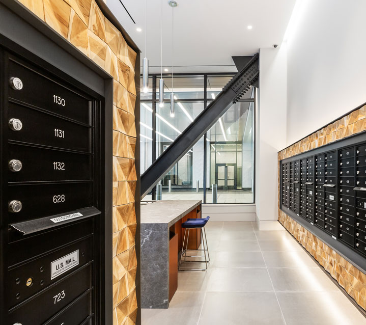 Apartment mail room with decorative wood paneling