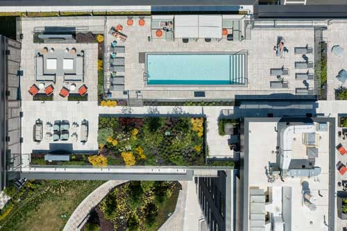 Aerial view of Ora's rooftop pool with outdoor grill area