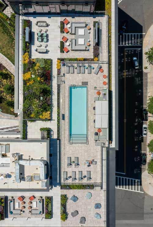 Full overhead view of Ora rooftop pool and surrounding amenities area