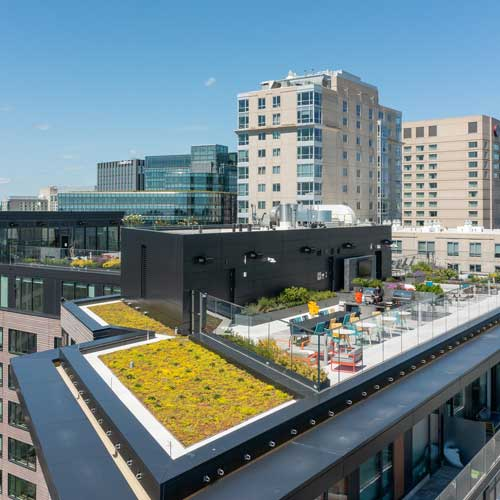 Aerial view of Ora rooftop amenities overlooking downtown Boston