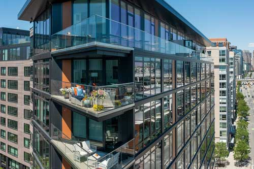 Aerial view of upper floor balcony at Ora Seaport apartments in Boston