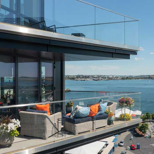 Luxury apartment balcony decorated with matching outdoor furniture