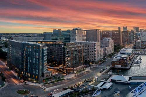 Ora Seaport luxury apartment building at sunset