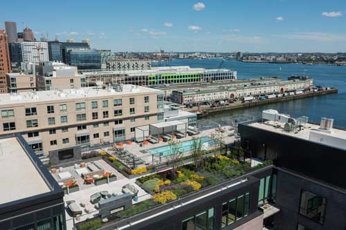 Aerial view of Ora rooftop pool and seating areas