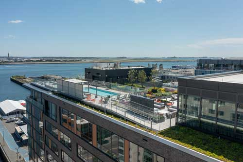 Aerial view of Ora rooftop amenities overlooking the Boston Seaport