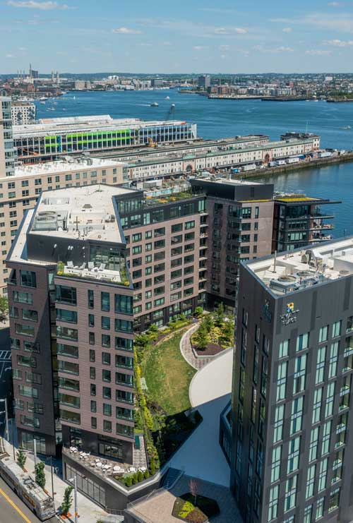 Aerial view of Ora Seaport Boston apartment building overlooking the harbor