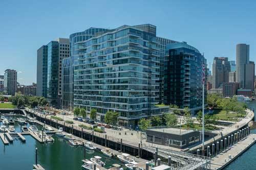 Aerial harbor view of Ora Seaport apartment building
